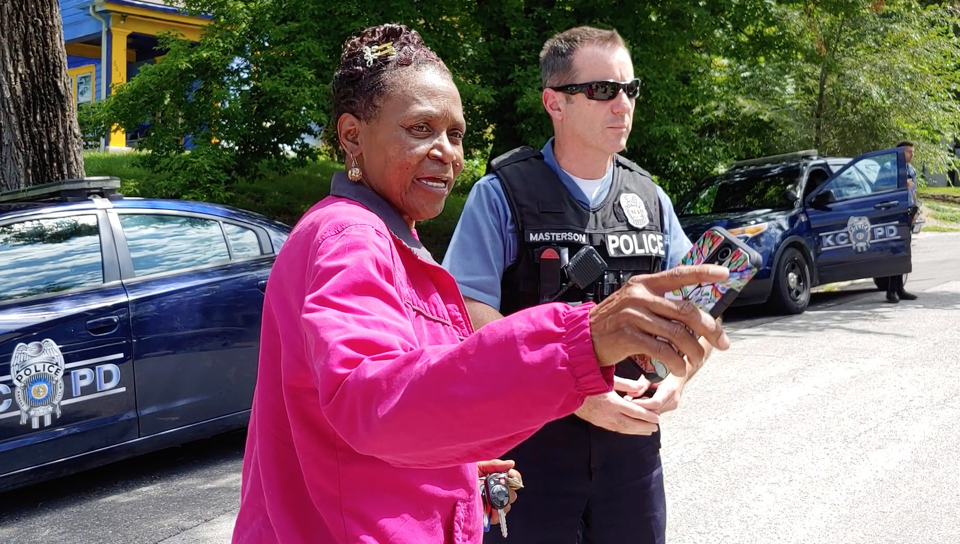 Nina Whiteside-McCord confers with Kansas City Police Community Interaction Officer Bryan Masterson