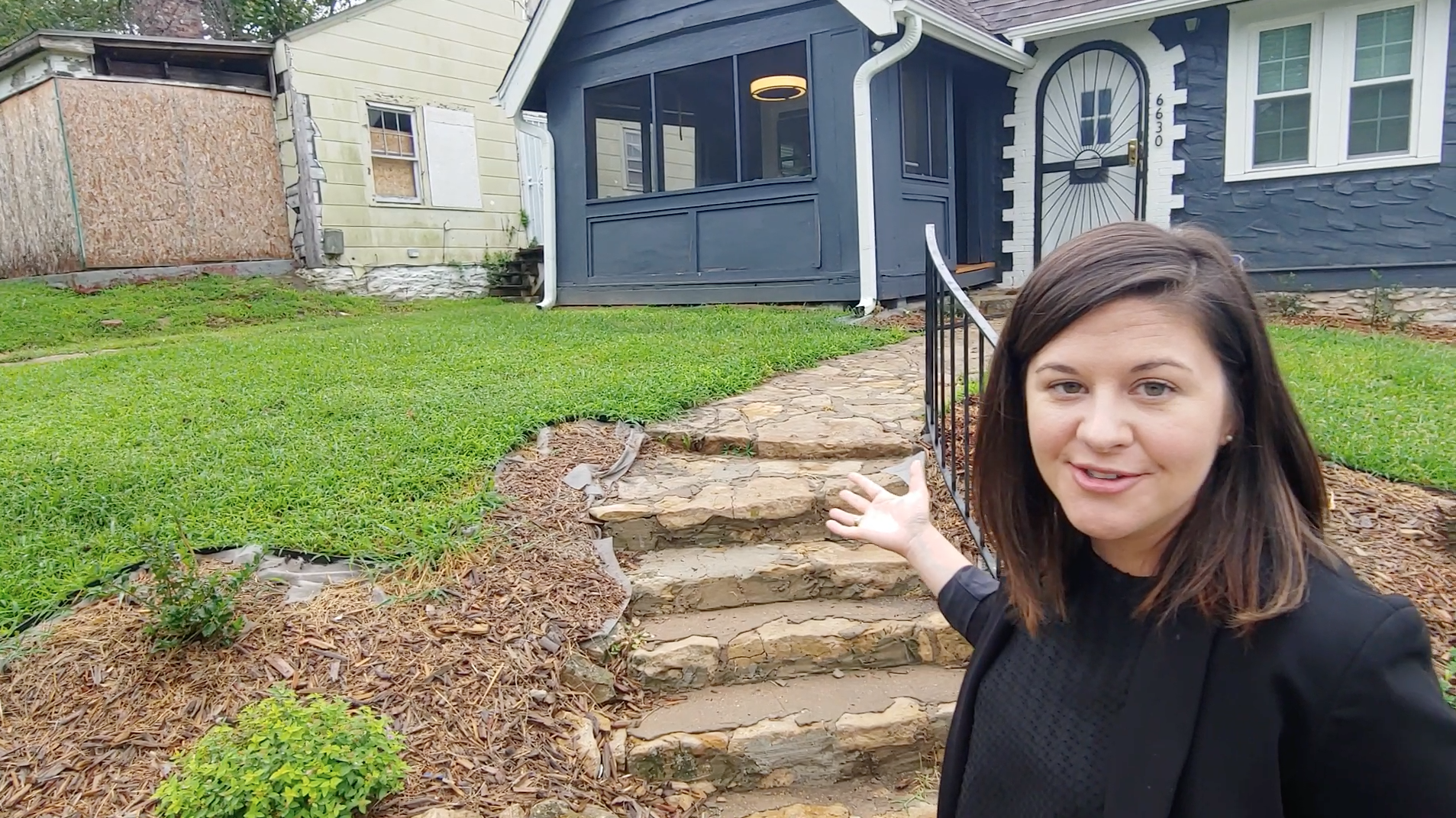 Attorney Anna Berman of Kutak Rock surveys the work rehabber Katie Chepulis has done with the help of Legal Aid of Western Missouri's Adopt-A-Neighborhood program.