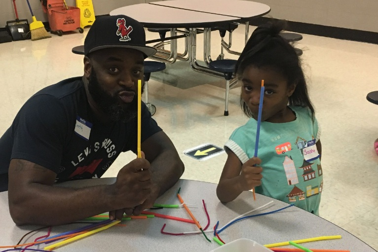 Smith Liddell and his daughter, Sasha Liddell, show off her craft idea at the first Fort Osage FAST family gathering Sept. 3.
