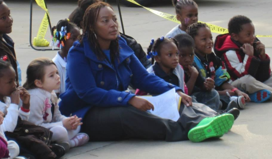 Yolanda Robinson has served as a site coordinator for LINC Caring Communities since 2012, and has led Faxon Elementary School's program since 2015. Here she sits with her Faxon students during a past Lights On Afterschool event.
