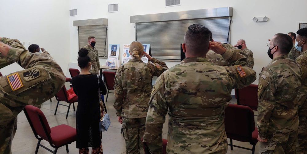 Members of the Missouri Air and Army National Guard salute Capt. Tony Rich at the Morning Star/LINC vaccination clinic on his last day of service with the Guard, May 13. Rich had extended his service by two months to remain on the vaccination mission.