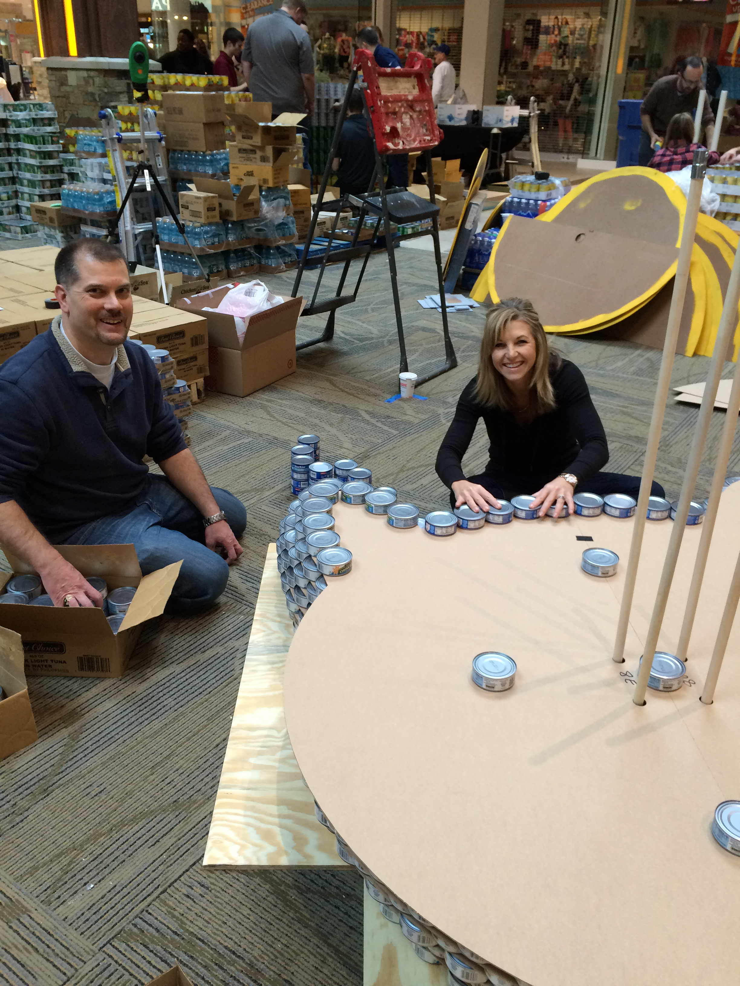 ACI Boland team members, Suzie Apel and Brad Guess, assembling the bottom layers of our Canculpture.