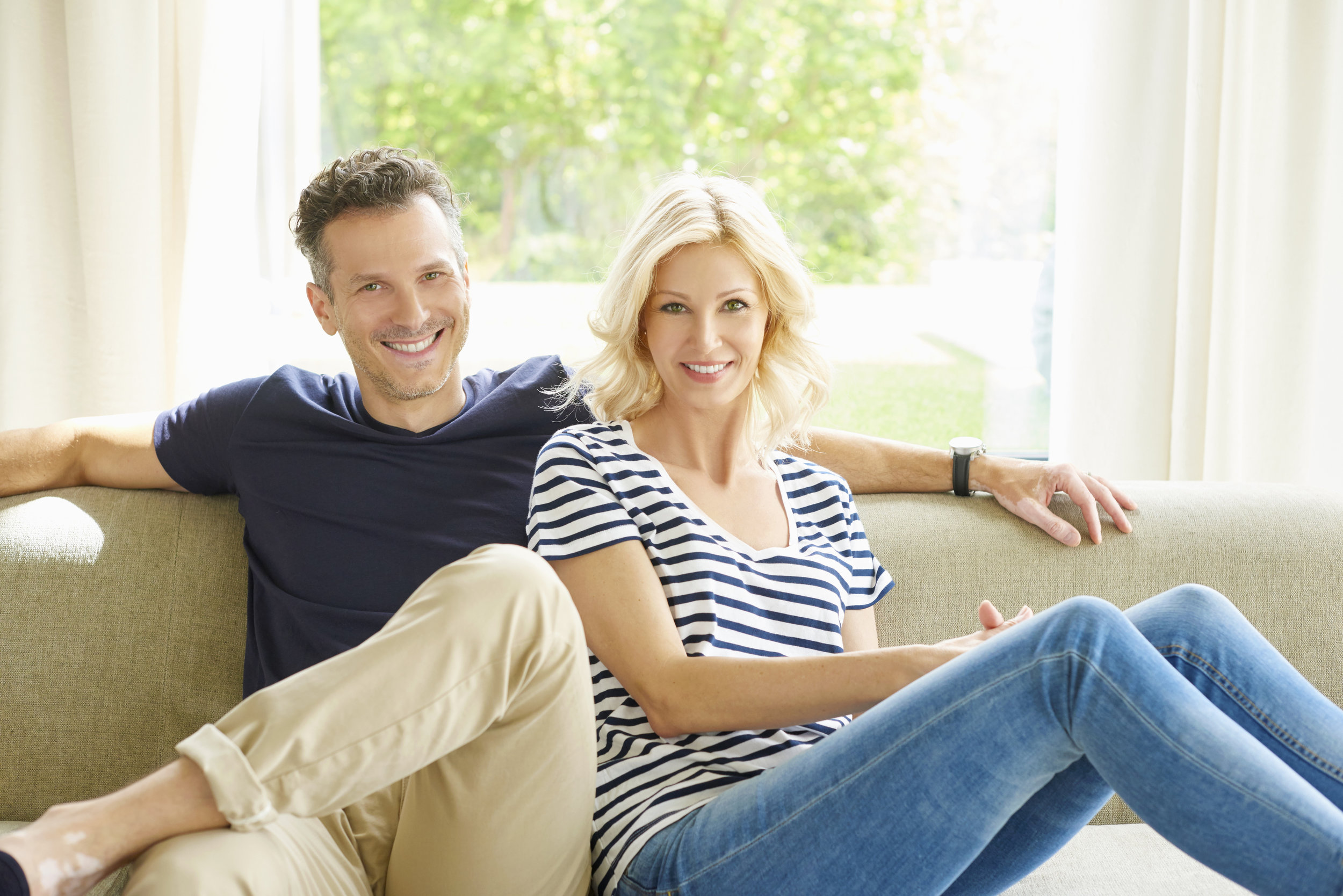 sally vail istock image couple smiling on sofa.jpg