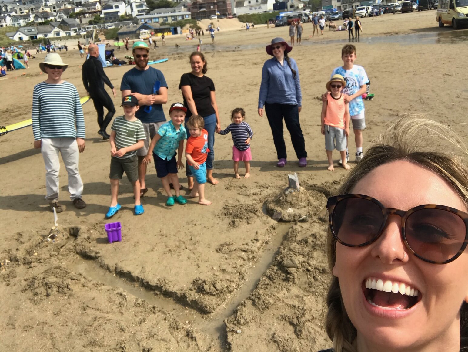 Sand building competition with the kids from our church social at the beach earlier this summer