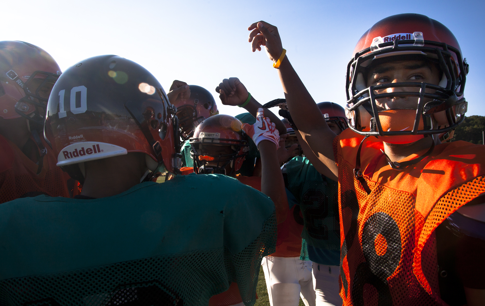 Myles Thomas, right, a senior with Central York High School gathers with his teammates on the football field during practice, Wednesday, Aug. 14, 2013. DAILY RECORD / SUNDAY NEWS - SONYA PACLOB
