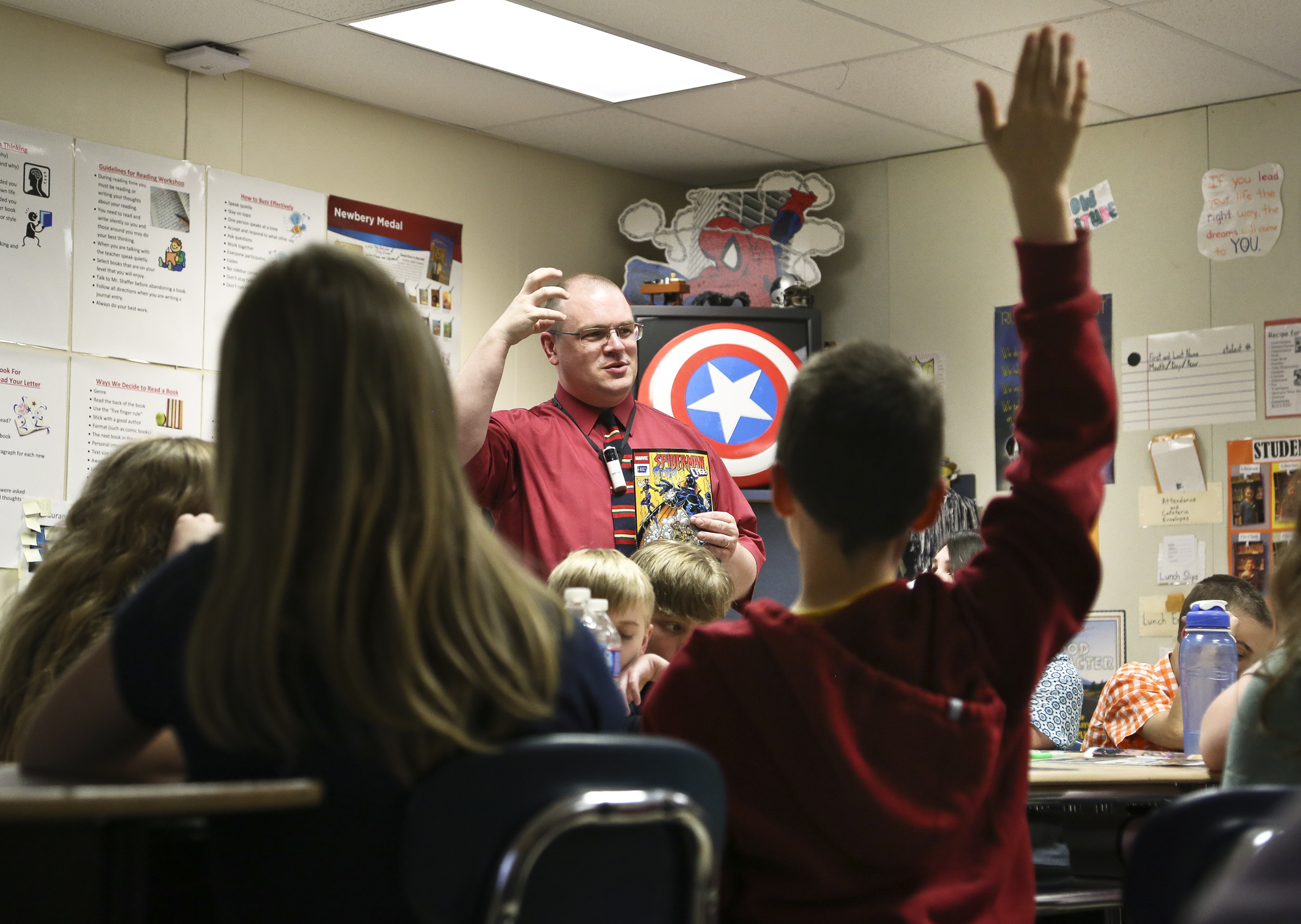 Fifth-grader Tyler Rake, 11 raise his hand while Scott Shaffer, communication arts teacher reviews the story of Spider Man, Storm and Cage with the battle of Smokescreen at South Eastern Middle School West, Fawn Township Monday, April, 28, 2014. Students weigh in their thoughts about smoking and the roles of the super heros in the comic book. Photo by Sonya Paclob