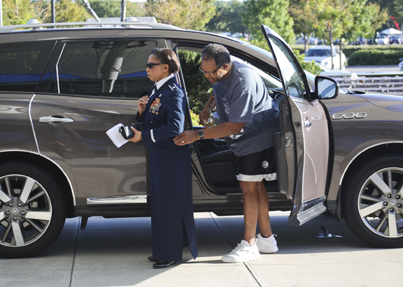 Lt Col Kathy Taylor has Dr. Reginald Taylor checks on her outfit before he drops her off at Langley Air Force Base 100th Anniversary Gala, Hampton, Saturday, Sept. 17, 2016.