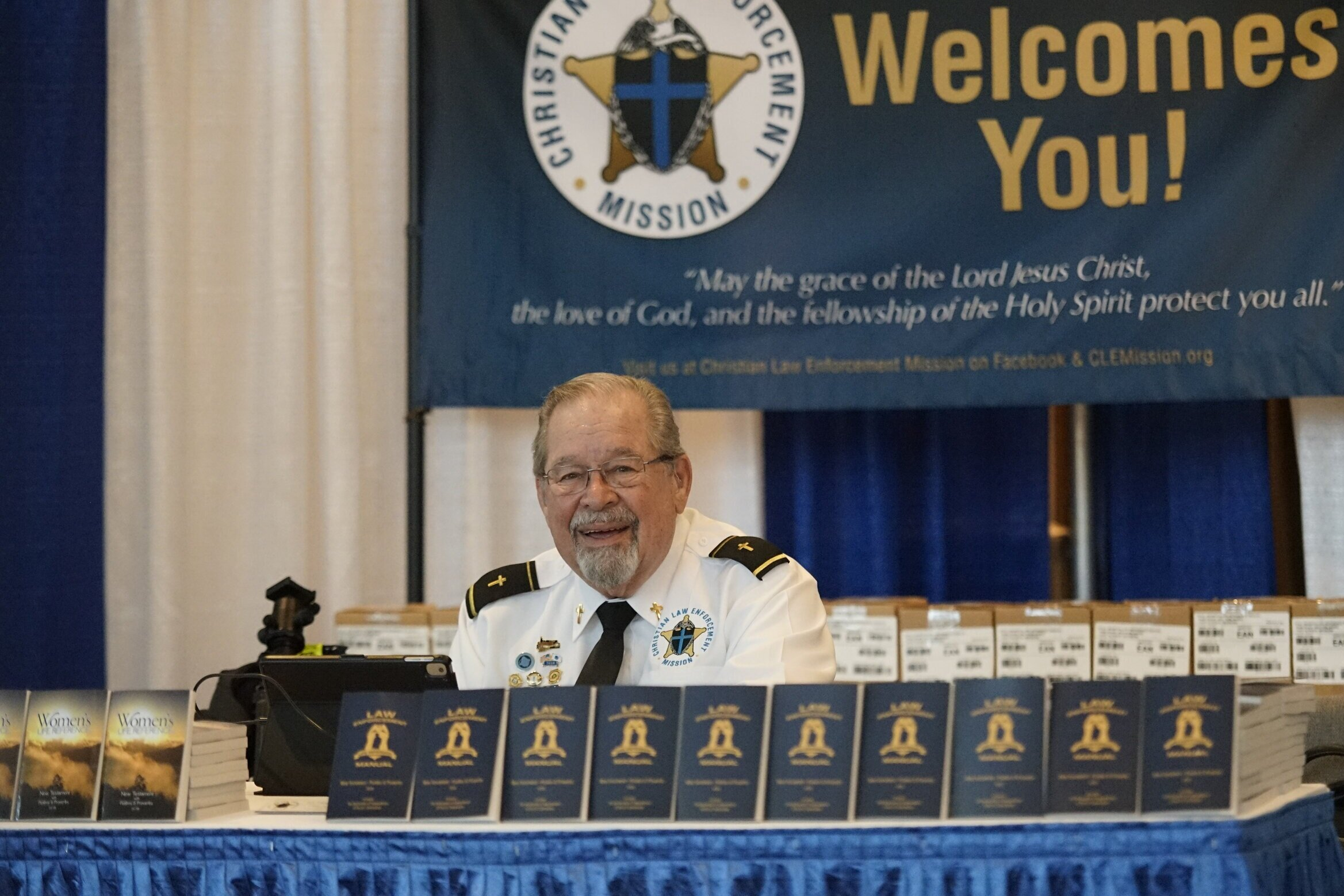 "Chaplain Tim Eldred, Chairman of National Sheriff's Association, Outreach Committee, ""Chaplain's Working Group"", greets attendees at the Christian Law Enforcement Mission Booth."