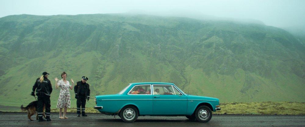 woman-at-war-2018-003-police-stopping-woman-car-mountainside.jpg