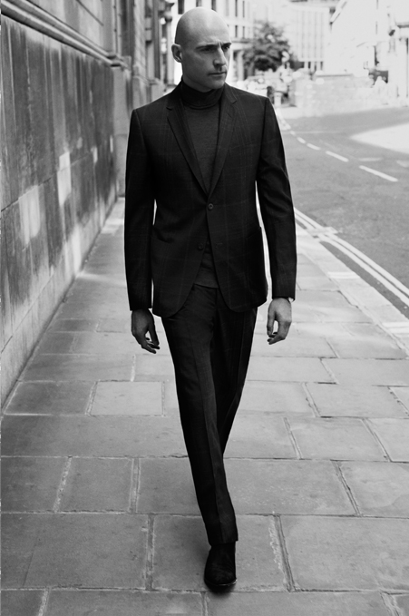 Suit by Gucci   |  Sweater by John Smedley    Boots by Paul Smith Shoes & Accessories