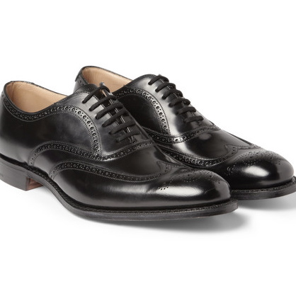 7. A pair of classic black lace-up shoes.