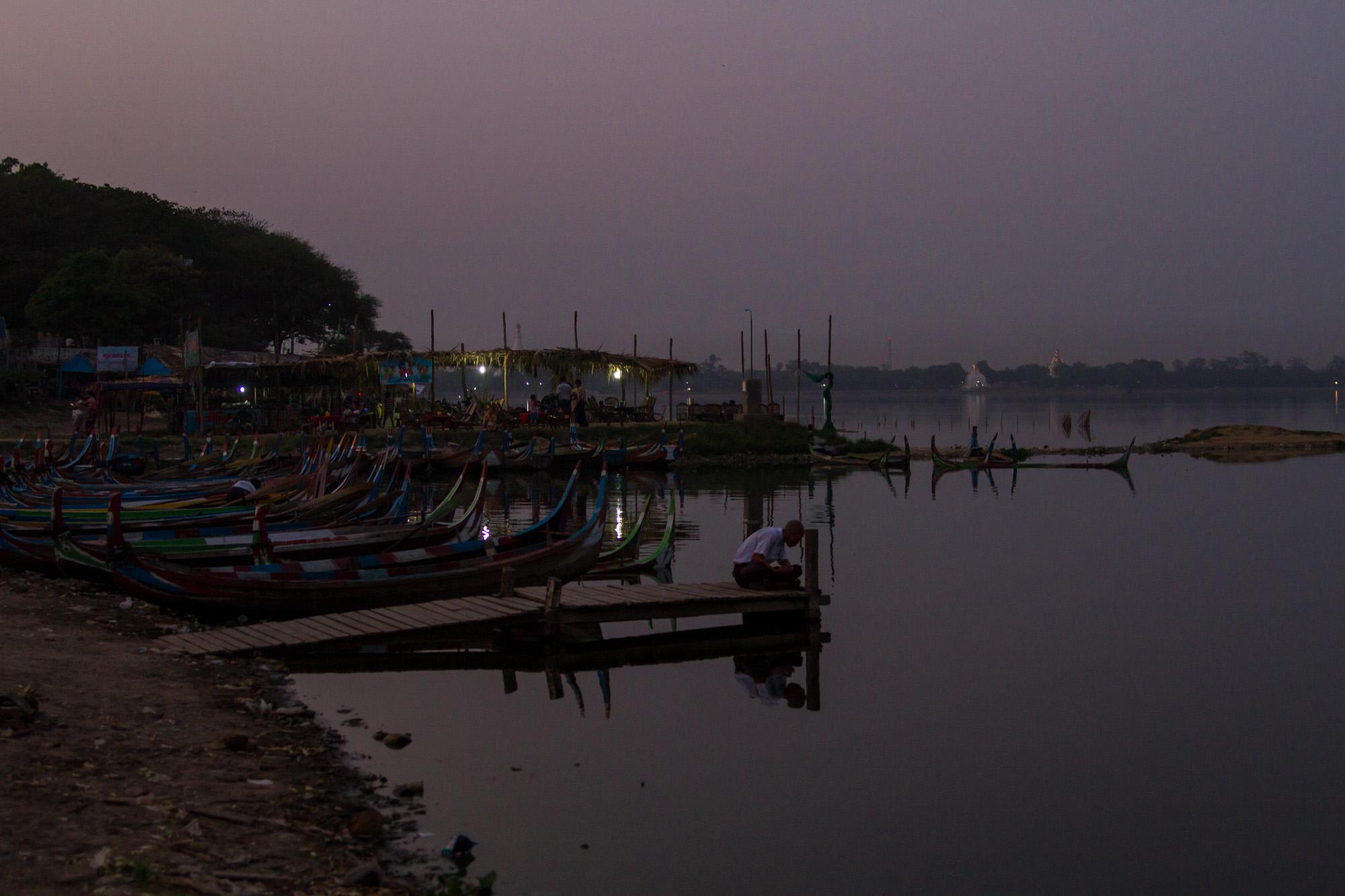 Young Burmeseon the pier at Taunghtaman lake.