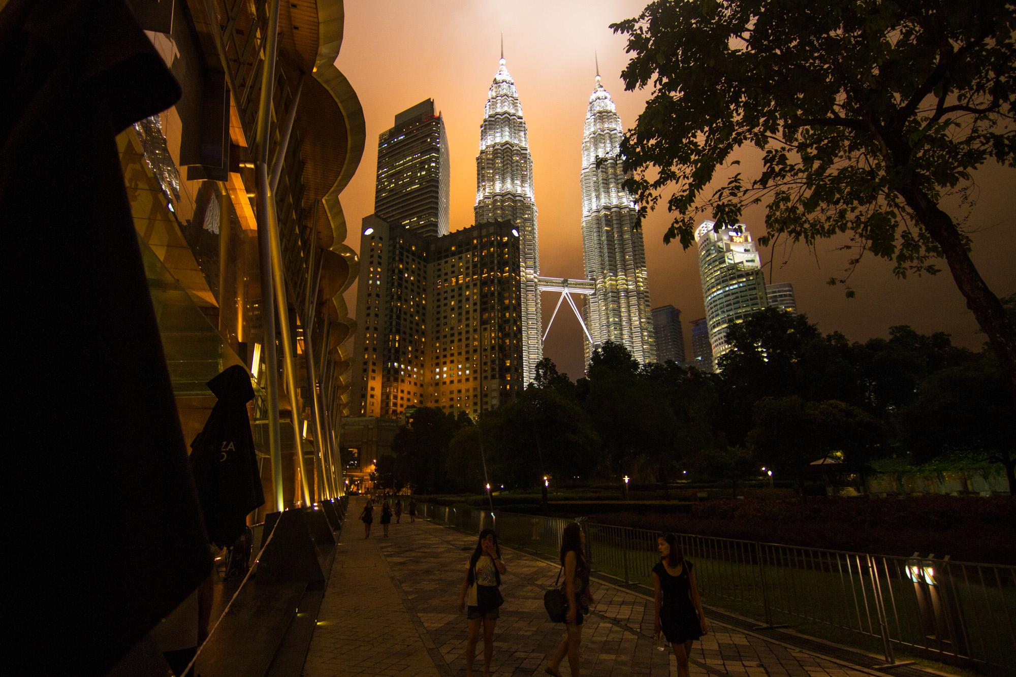 Petronas Towers  illuminated on a cloudy night in Kuala Lumpur