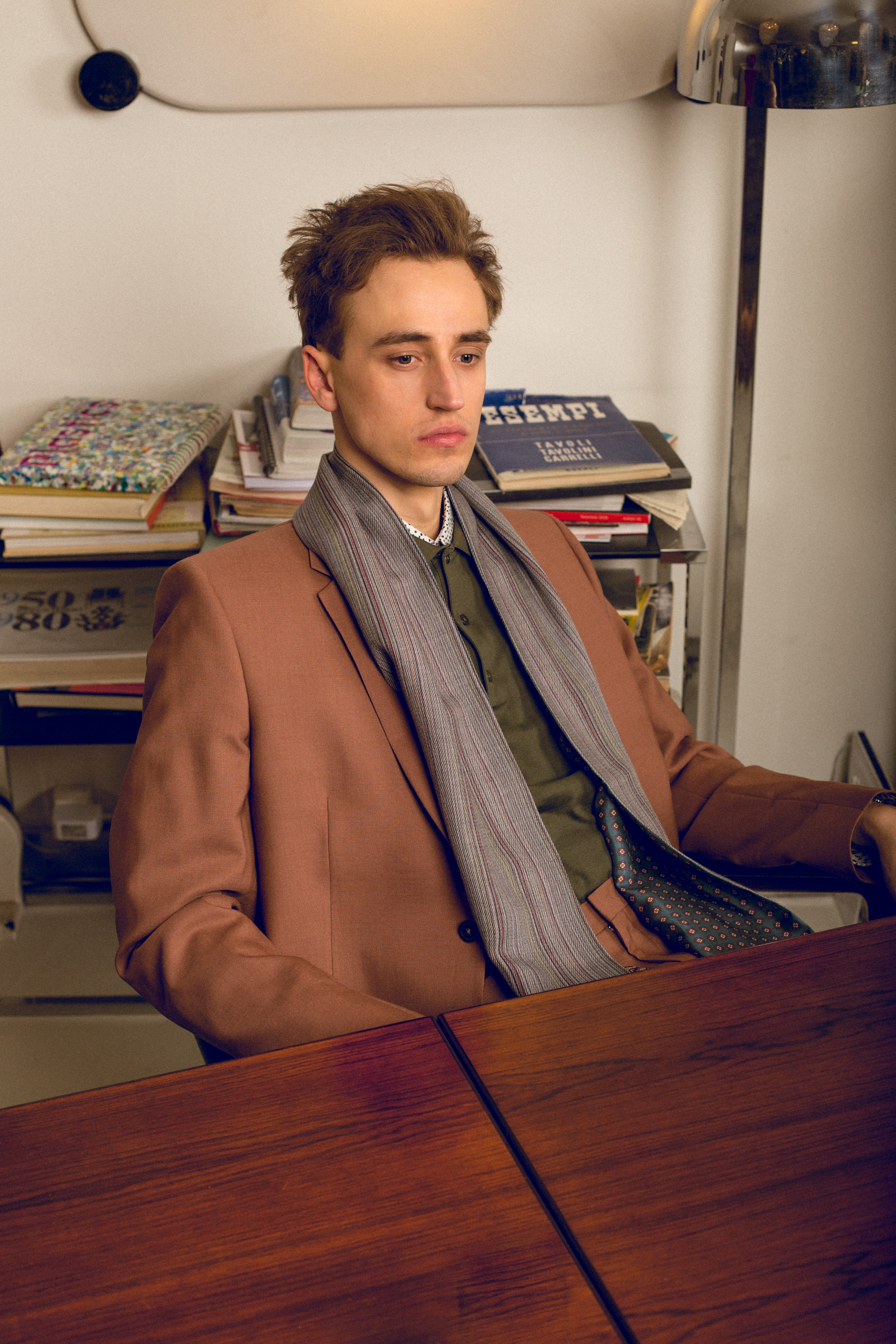 Moritz is wearing a Paul Smith blazer, shirt and scarf and a J. Lindeberg Polo shirt.