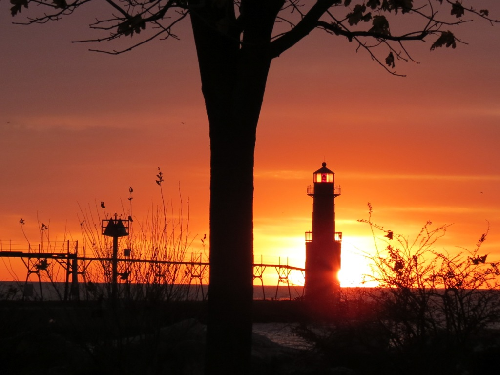 Lighthouse with sun in background.jpg