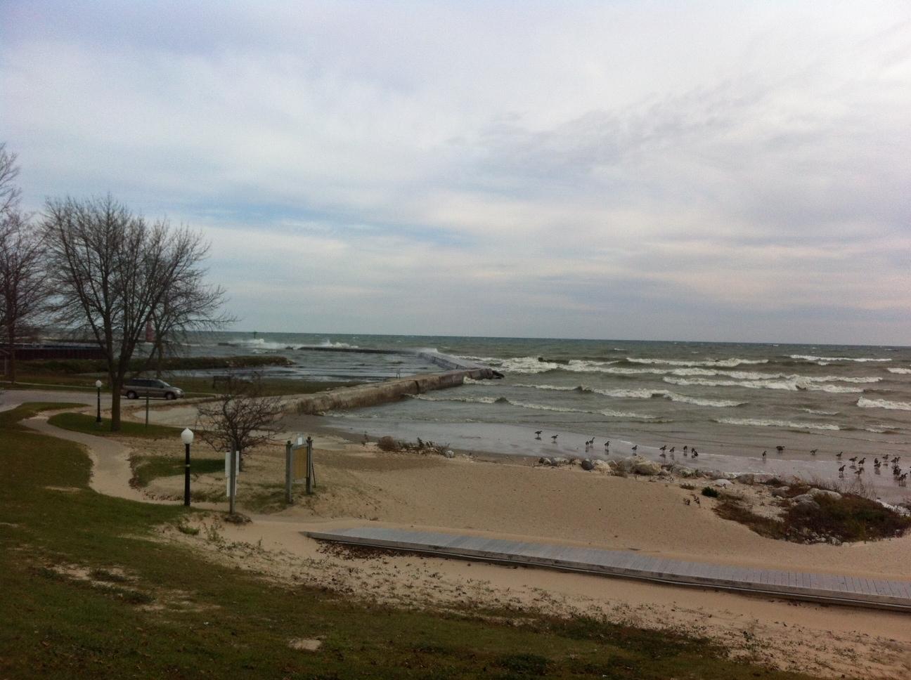 Waves crashing over breakwater.jpg