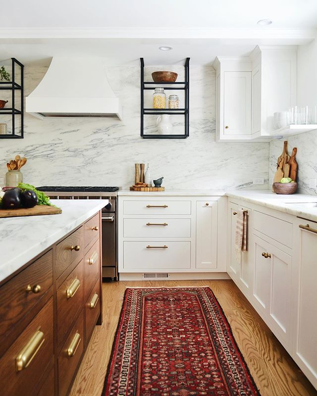 This kitchen is ready for the world now. 😂 It's near and dear to our hearts- so many small details were worked and reworked for it to come together. A year+ in the making and our job is finally done! We love you marble wall, dark oak island, custom metal shelving and literally everything else. 💗Swipe for the before, check stories for BTS styling, our In Progress stories for how she came to be, and stay tuned for more pics!!!Whew. #rehabitatinteriors