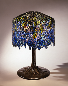 Image: Tiffany Studios, Clara Driscoll (1861-1944), designer,  Wisteria   Library Lamp , circa 1901, leaded glass and bronze, The Neustadt Collection of Tiffany Glass, Queens, NY, N.86.IU.7a,b
