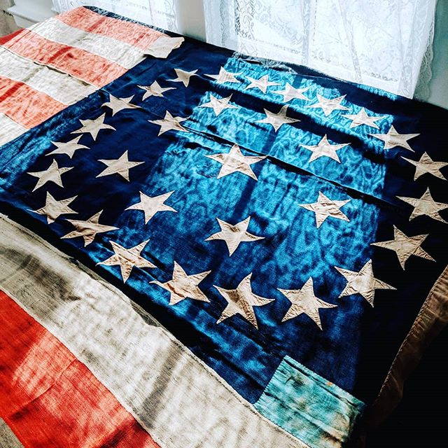 This large 31 star flag was flying on Fourth Street in Cincinnati OH between 1851 and 1861. When we found it in an attic trunk it was folded up and hadn't been touched for decades. The stars are beautifully hand-cut and you feel the quilting that went into each piece of fabric. Measuring an impressive 10 x 15 feet we look forward to seeing it up again soon.