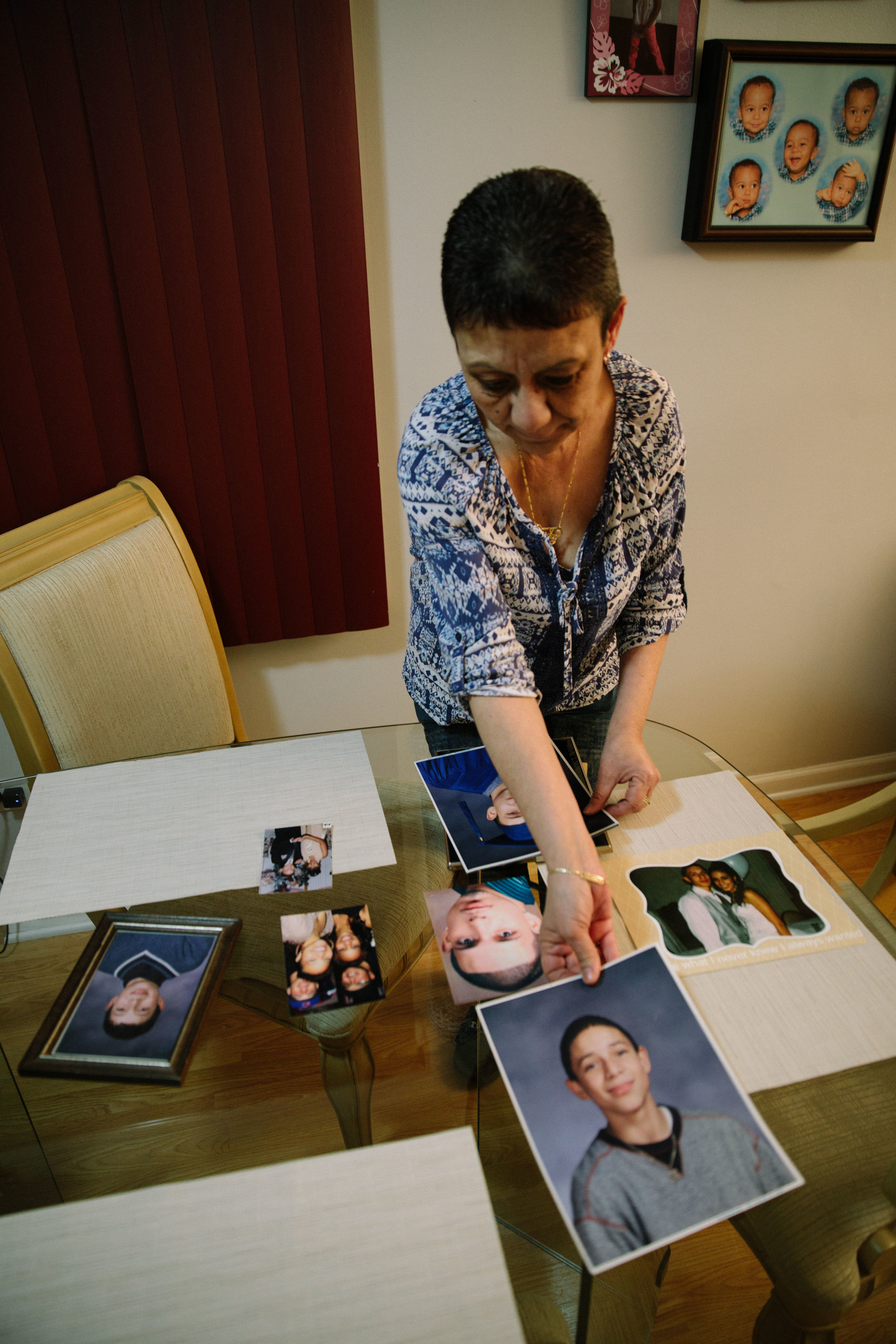 Elizabeth Ramirez lays out photos of her son, Dee Jay Rodriguez, on the dining room table. In October 2011 Dee Jay was shot and killed in his apartment in Chicago's Bellmont-Cragin neighborhood. In the aftermath of her son's murder, Elizabeth helped found Parents for Peace and Justice, a support and advocacy organization that comes alongside families who have also lost children to gun violence in Chicago. MCC partners with Parents for Peace and Justice to help support their important work.