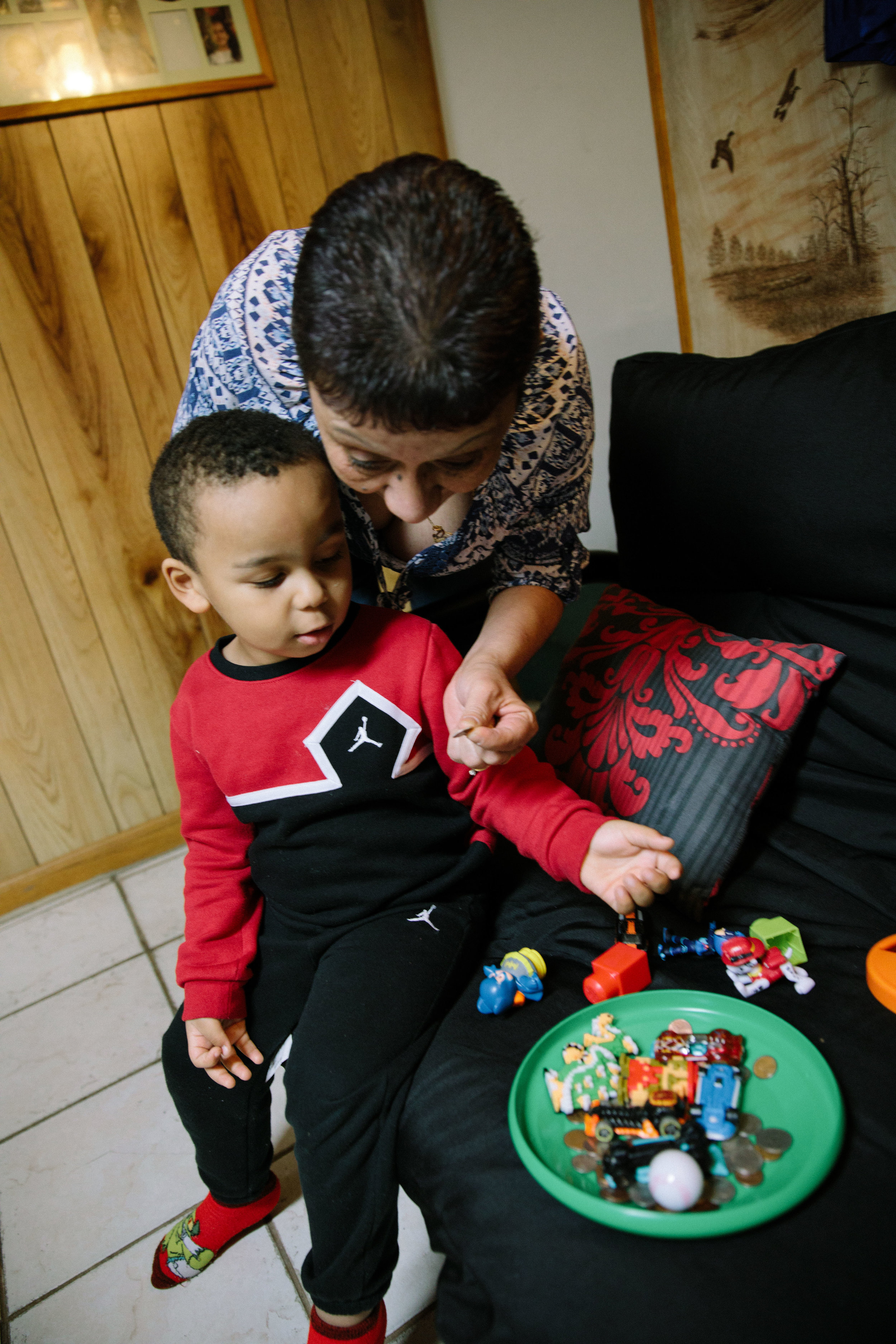 Elizabeth Ramirez plays with her three year old grandson, Dee Jay, who was named in honor of her late son, Dee Jay Rodriguez. Elizabeth's son was shot in killed in October 2011, four years before his nephew and namesake was born. Elizabeth helped found Parents for Peace and Justice, a support and advocacy organization that helps families who have also lost children to gun violence in Chicago. MCC partners with Parents for Peace and Justice to help support their important work.