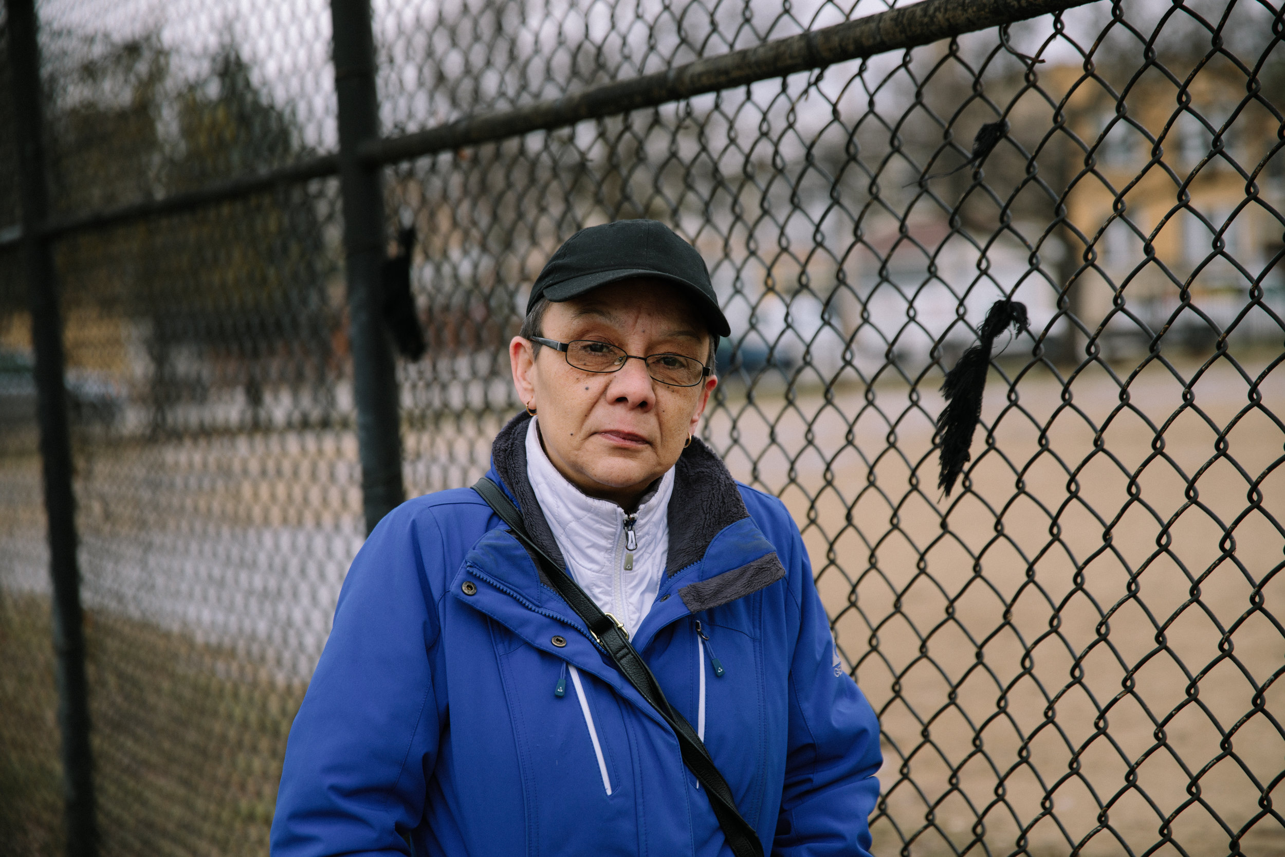Elizabeth Ramirez stands in Blackhawk Park in Chicago's Belmont-Cragin neighborhood. Elizabeth's late son, Dee Jay Rodriguez, attended his first sports camp at Blackhawk Park and there is an honorary street named after him along the park's border. Dee Jay was shot and killed in October of 2011 as he celebrated his upcoming 24th birthday. In the wake of his death, Elizabeth helped found MCC partner organization, Parents for Peace and Justice, a support and advocacy organization for families who have lost children to gun violence in Chicago.