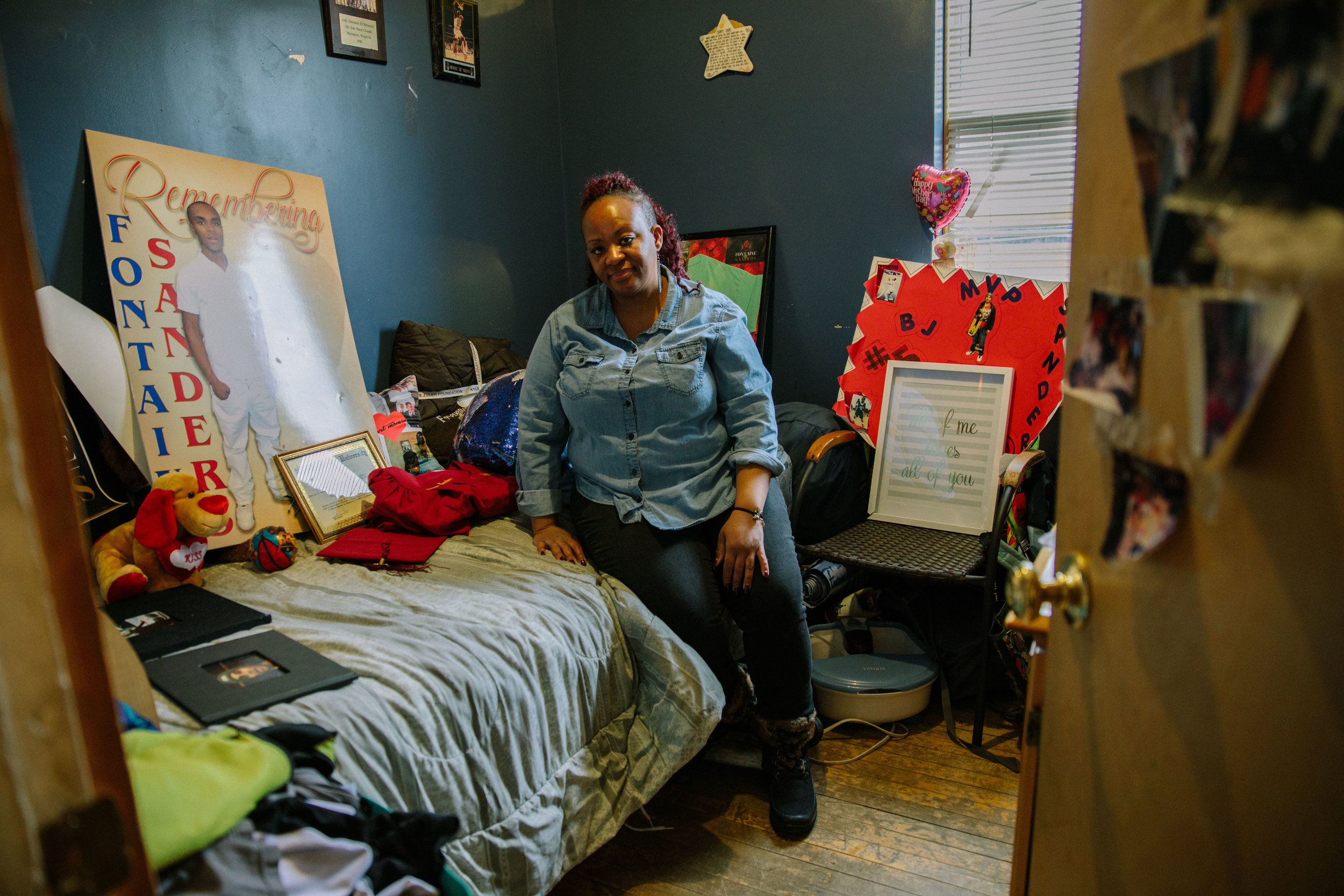 """Corniki Bornds sits on the bed in the room of her late son, Fontaine """"BJ"""" Sanders. BJ was shot and killed as he walked to Franklin Park to play basketball with his friends in 2017. Corniki said it was too painful to enter her son's room for over 6 months after his murder, but now she finds solace inside. Corniki often sits in her son's room to journal, think and look at momentos of him. In the wake of her son's death, Corniki found support through other mother's who have lost children to gun violence in Chicago in a support group run by Parents for Peace and Justice. MCC partners with Parents for Peace and Justice to help support their advocacy and support work in Chicago."""