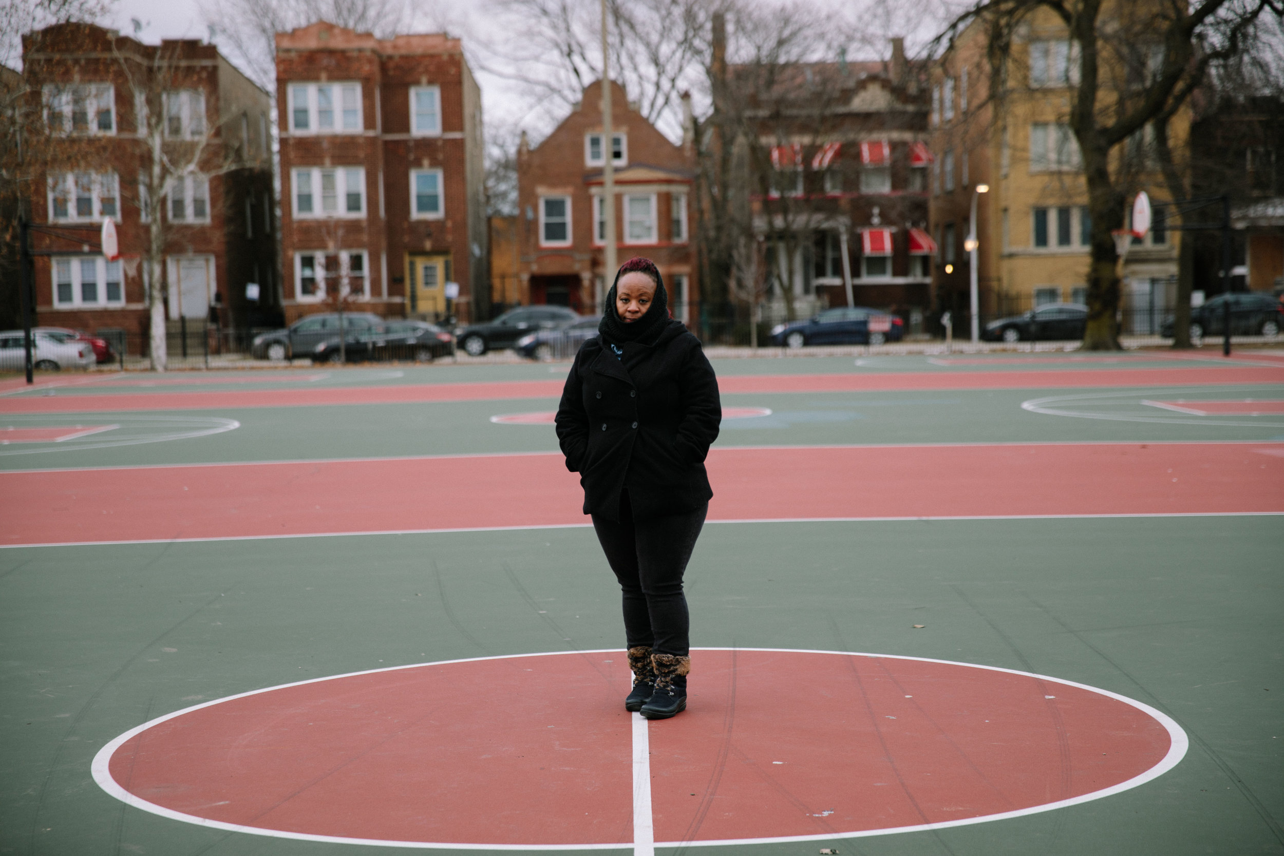 """Corniki Bornds stands on the basketball courts at Franklin Park on Chicago's west side. In 2017 Corniki's only son, BJ, was murdered in a non-targeted shooting as he walked to the park to play basketball with his friends. Corniki shares, """"I tell everybody when I go there, 'I'm not going to claim this as the place where my son died - its the place my son lived. I have more memories of his life here than his death, so I'm not going to associate it with that, even though that's what it is.'"""" In the aftermath of her son's death, Corniki found support through other mothers who had also lost children to gun violence. The support group is run by Parents for Peace and Justice, a support and advocacy organization in Chicago. MCC partners with Parents for Peace and Justice to help support their important work."""