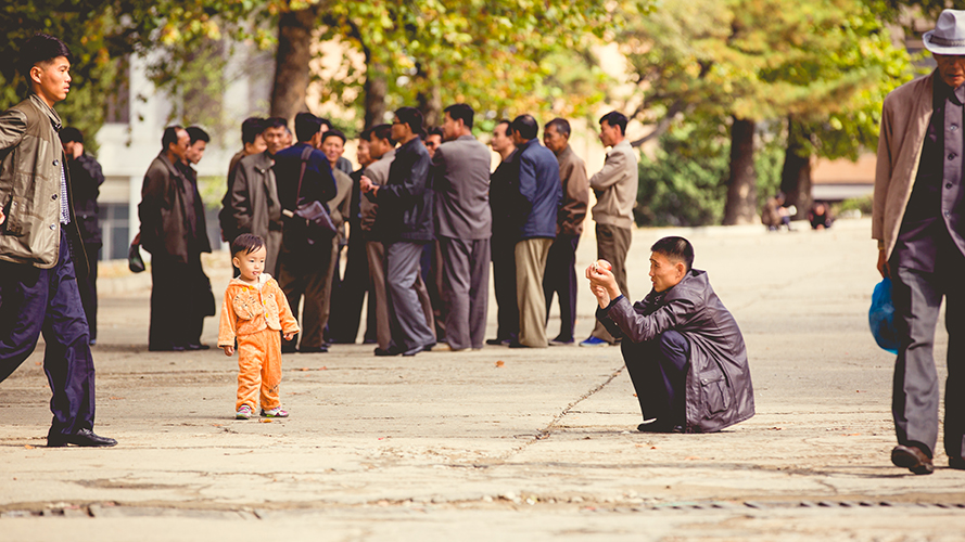 Father taking a picture of his son