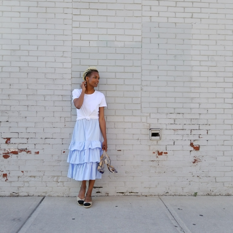 OVER A FRILLY DRESS