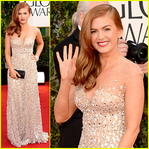 Isla Fisher: Her look was stunning. The style and color of dress was perfect for her body and hair color. The look was complete with her soft, shiny, side-swept hair, simple jewelry, and the makeup with flawless skin, neutral eye, defined brown and bold lip.