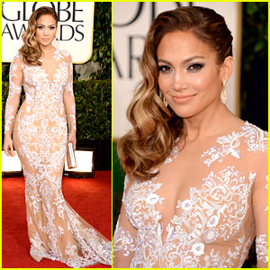 """Jennifer Lopez: Job well done this time J Lo. Revealing, yet tasteful dress that covers all the right spots paired with simple jewelry. Mermaid dress is perfect for her body type. Makeup has that """"J Lo Glow"""" and soft cat eye makeup creates an """"eye smile"""". Love this hairstyle with her look although I do wish it was a softer groomed look on the side... curls are perfect though."""
