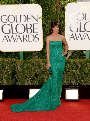 Shaun Robinson: Classic cut to the dress yet the textures and train make this piece! The emerald green paired with her darker skin and brunette hair is perfect. The matching clutch pairs well with her dress. I do think this look could be gorgeous with a sleek updo and a red lip. (The complimentary colors of red and green make the eyes pop!)