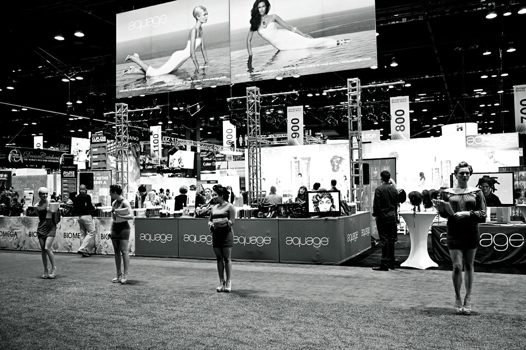 The doors are about to open. Models are in place in front of our booth to greet ABS show goers, as well as on stage to showcase beautiful hairstyles.