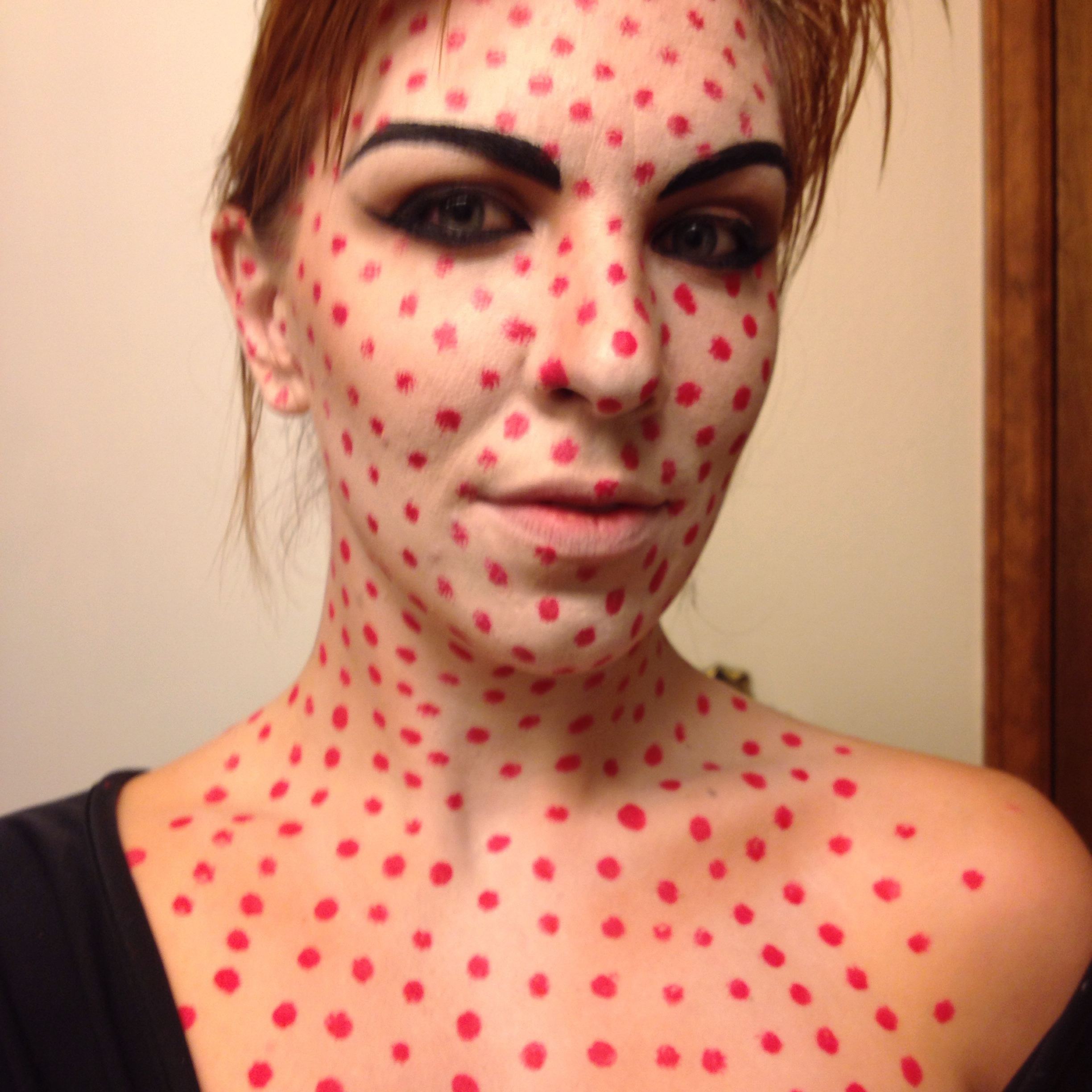 """Use a red face paint such as Mehron or Ben Nye, and a small crease brush to create dots on your face aka """"crappy printing"""". Make sure to create lines with the dots to keep it consistent."""