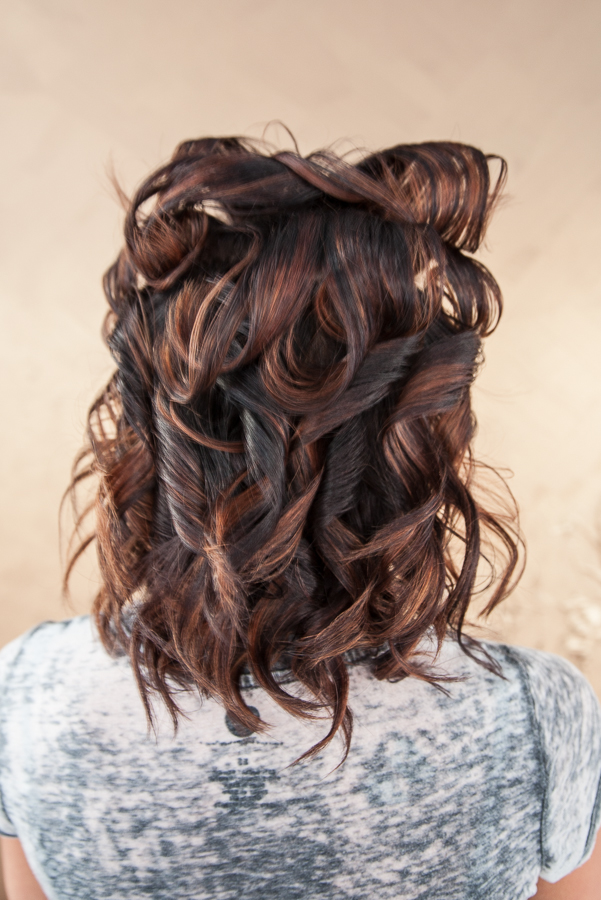 On the top section of the hair, do the flat iron curls the same as before, only turning the flat iron under instead of up. This will give you more volume on the top.