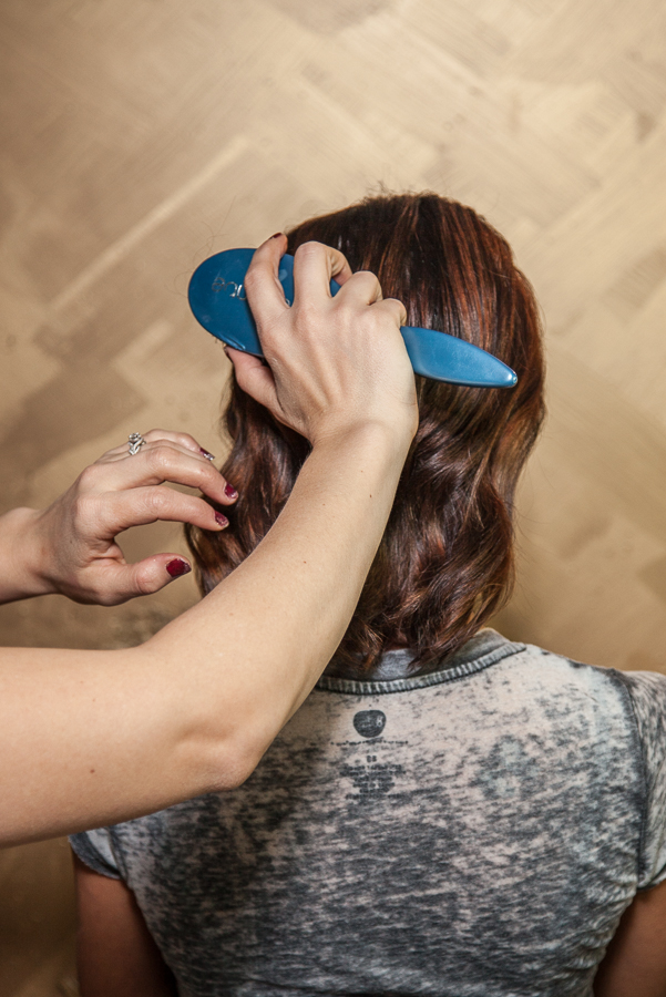 Once the curls have cooled down, brush through the hair. I like the  Aquage Smoothing Brush  because it just softens and shines the surface without flattening the hair.