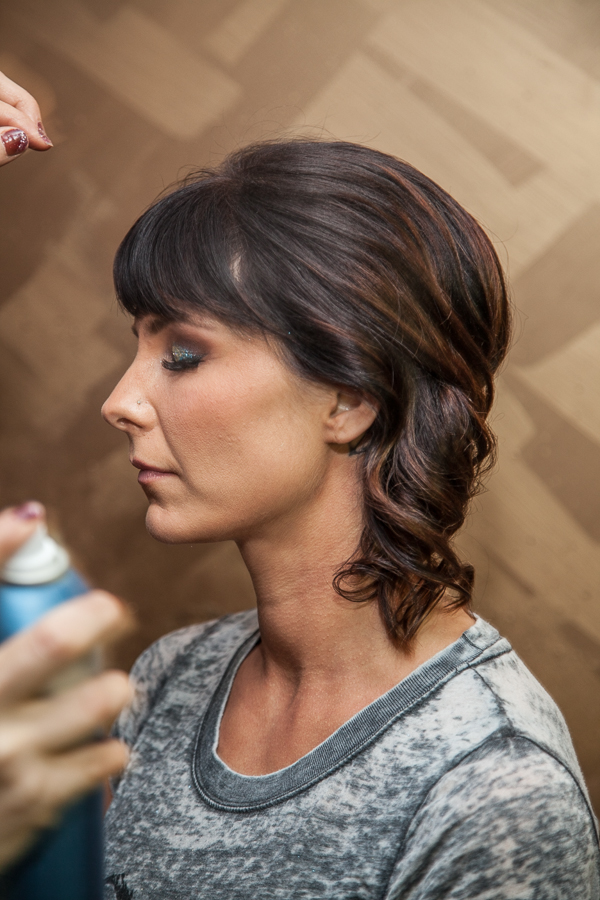 8-10 inches away, spray the hair all around to lock in. And here's your finished look.