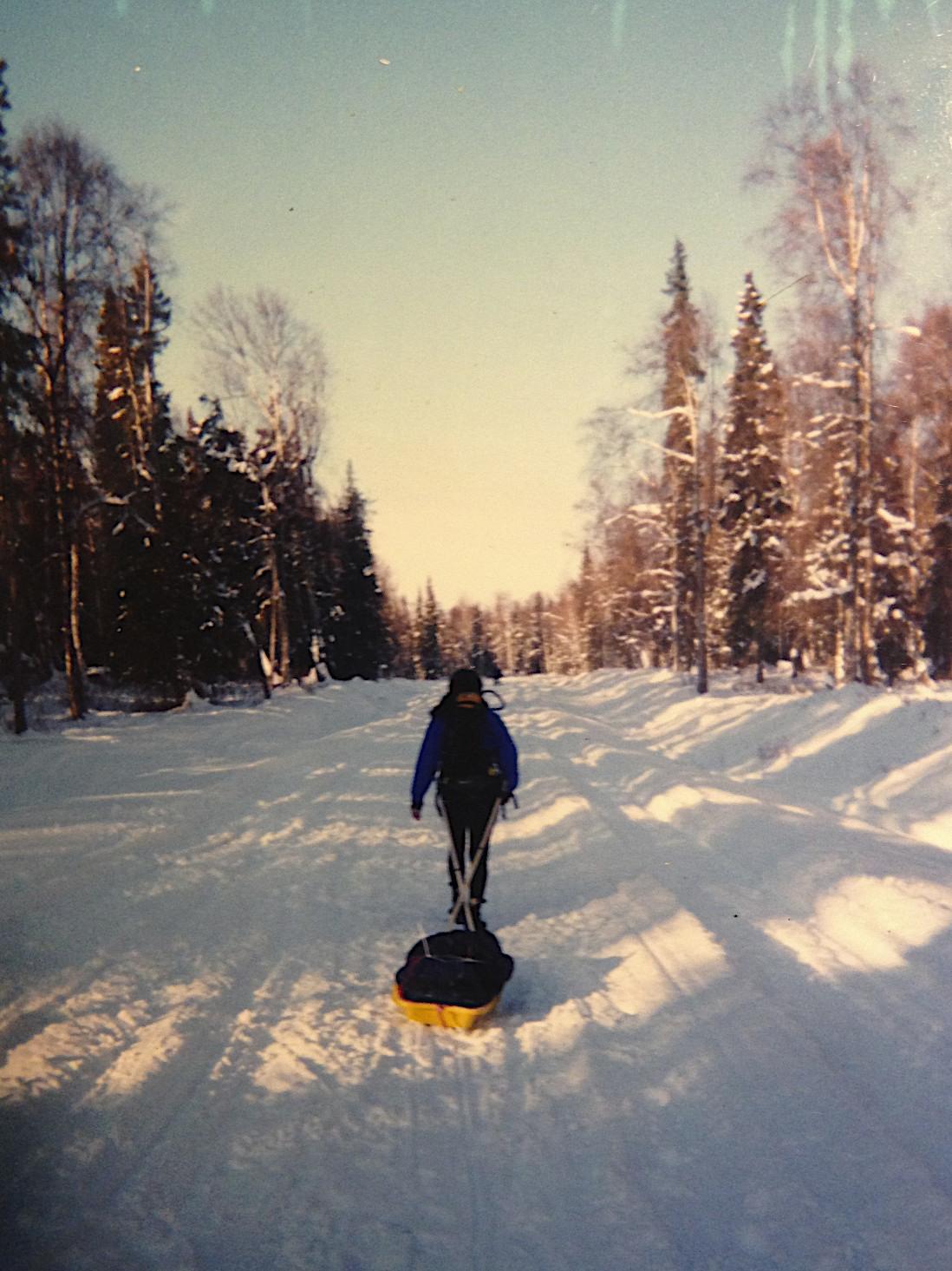 Elizabeth pulling her mandatory sled of gear during the 2000 Susitna 100 in Alaska.