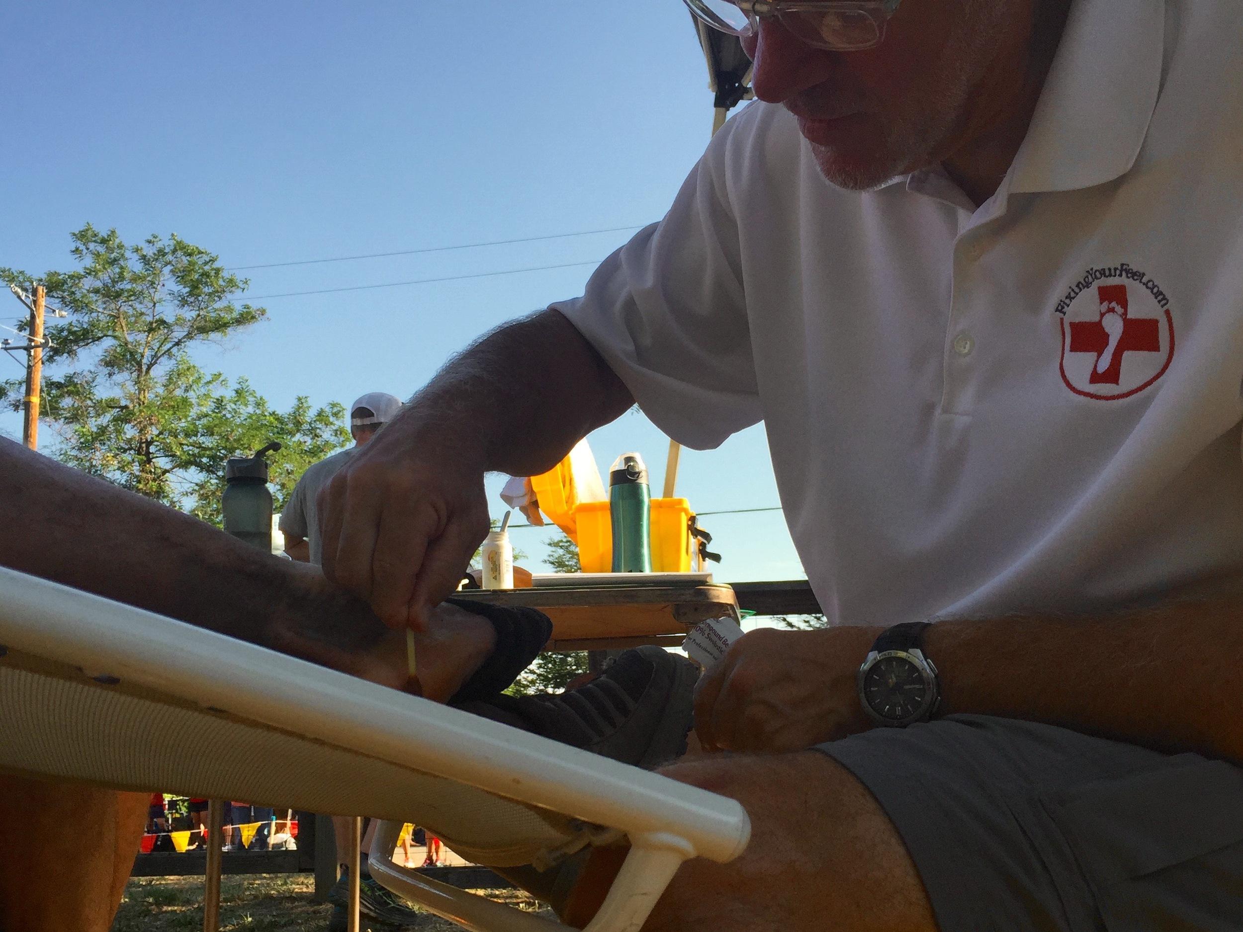 Harry getting his feet worked on by John Vonhof.