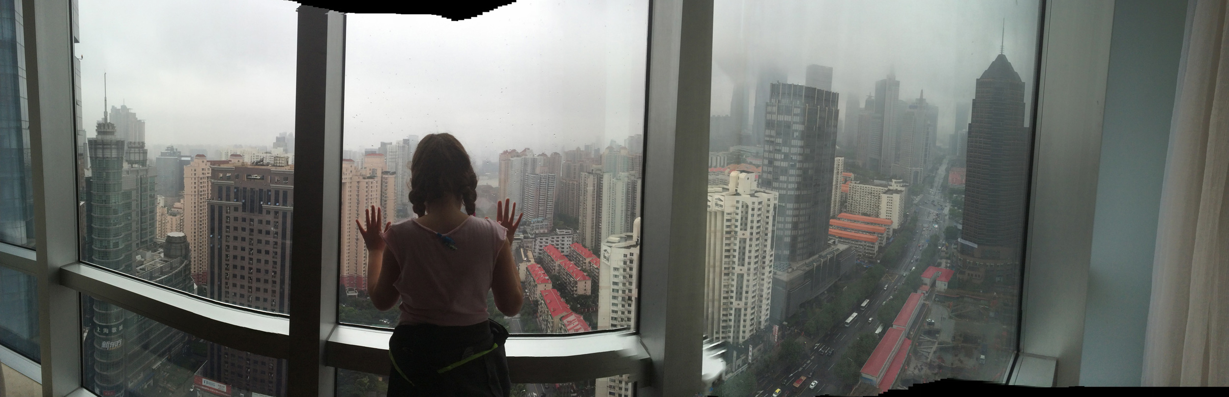 Lucy contemplates the view of Shanghai