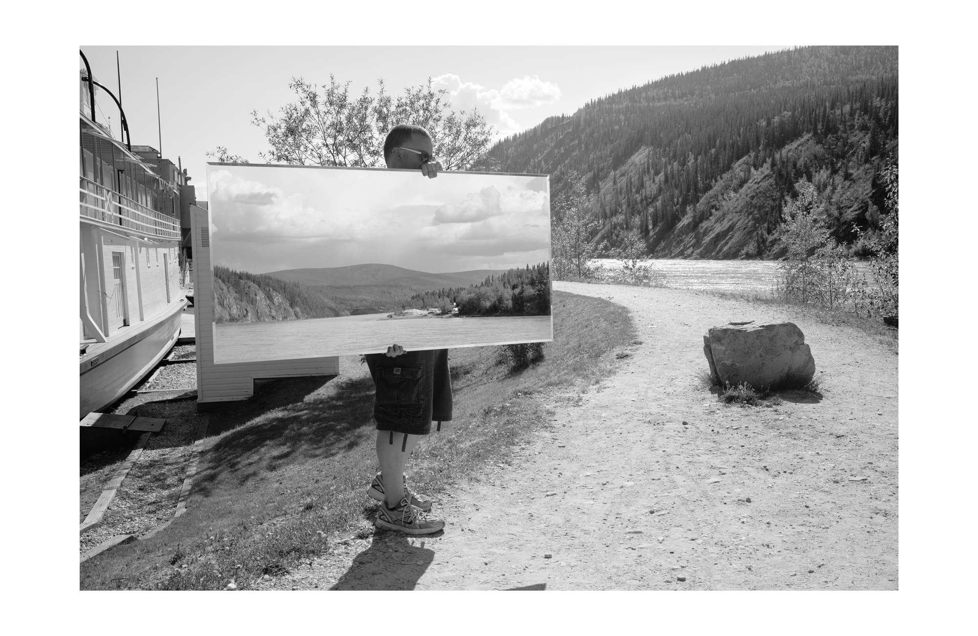 Dawson Looking Glass 1, 2015, documentation of performance (photographic print, 40 x 26 inches, edition of 5, 1 artist proof)