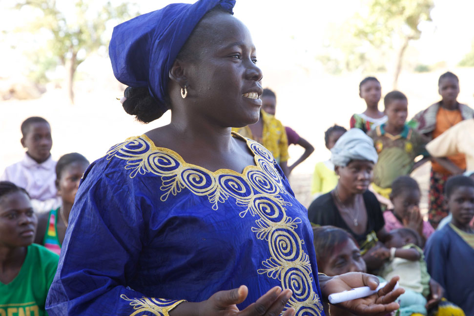 Rihanata Ouedraogo is a local mayor and Gascode peer educator. Here she leads a group discussion about female genital mutilation (FGM) in Koassinga village, Burkina Faso.   Flickr / DFID - UK Department for International Development