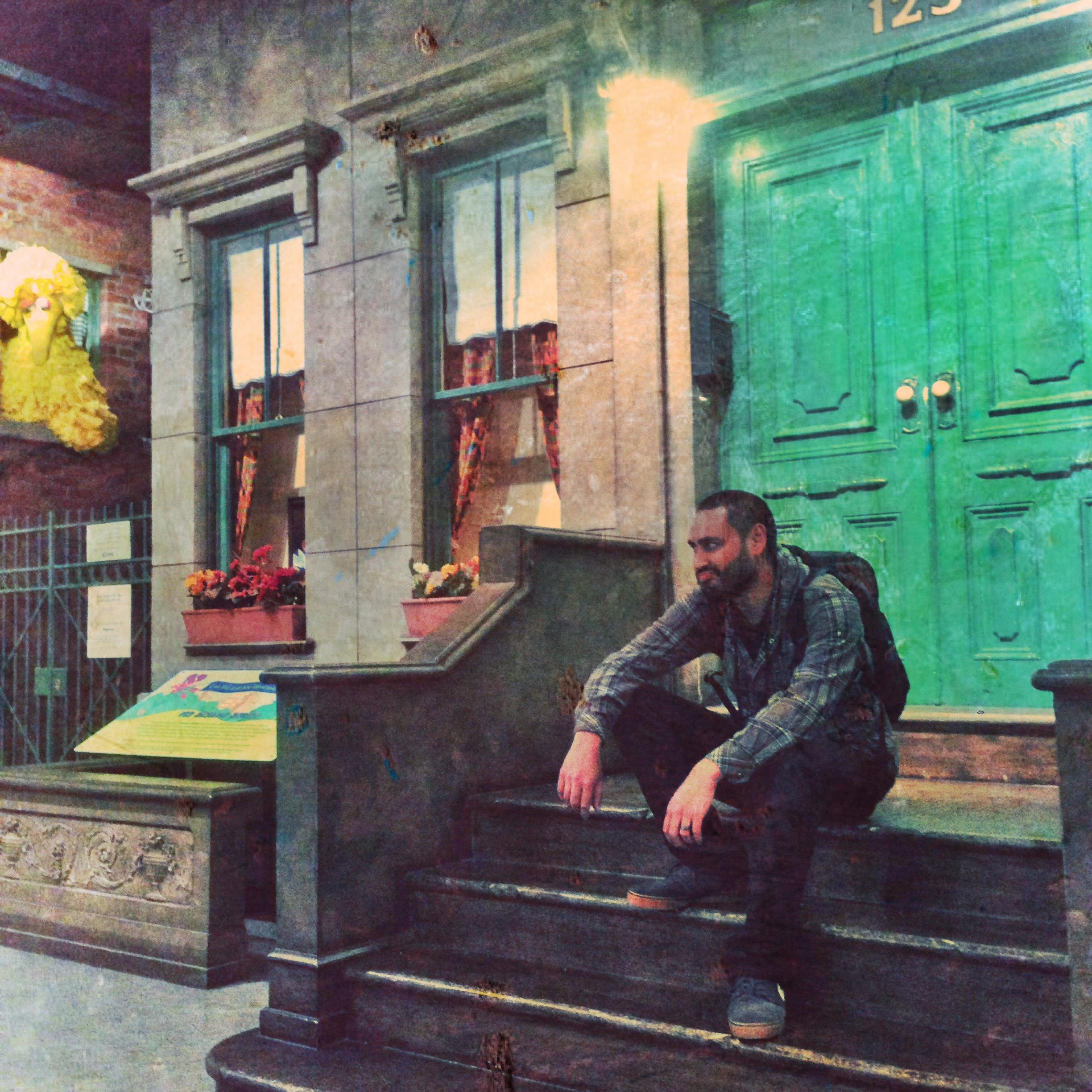 The National Museum of Play in Rochester NY has a recreation of the iconic Sesame St. set-piece. Jason is waiting for Big Bird.