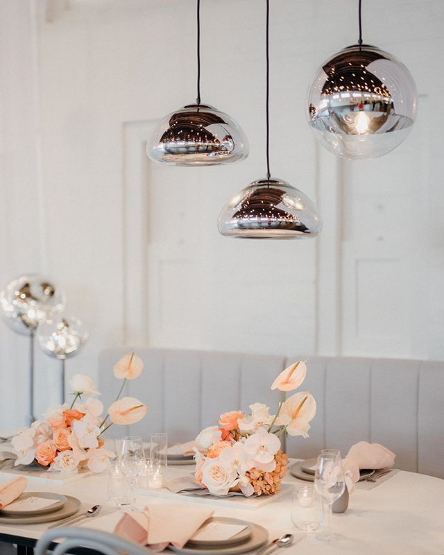 Sherbet tones + chrome for a refreshing modern wedding look.  Photo | @amanda_thomas_photography  Furniture | @darbyandgrey  Lighting | @lalumiere_nz  Styling + Florals | @libertyeventstyling  Venue | Tote on Ascot @ellerslieraces  #weddingvenue #weddingdecor #nzweddings #eventstyling #weddingflorals #eventstylist #weddinginspiration #libertyeventstyling #weddinglights #modernwedding #nothingisordinary