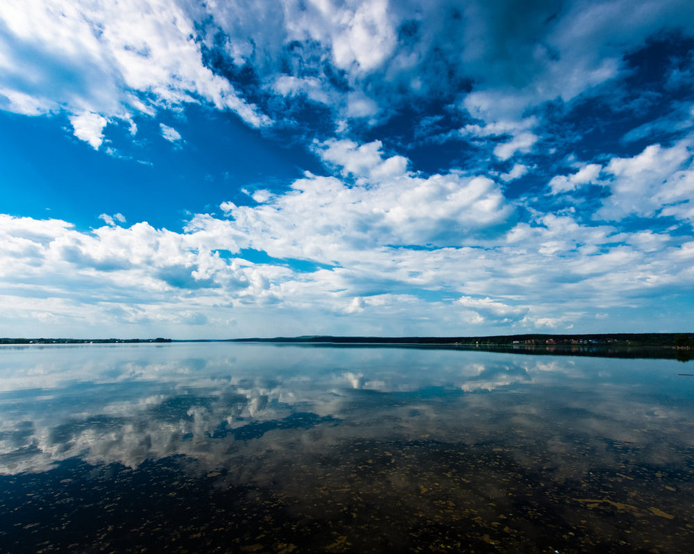 clouds_over_water_by_moitisse-d3is21n.jpg