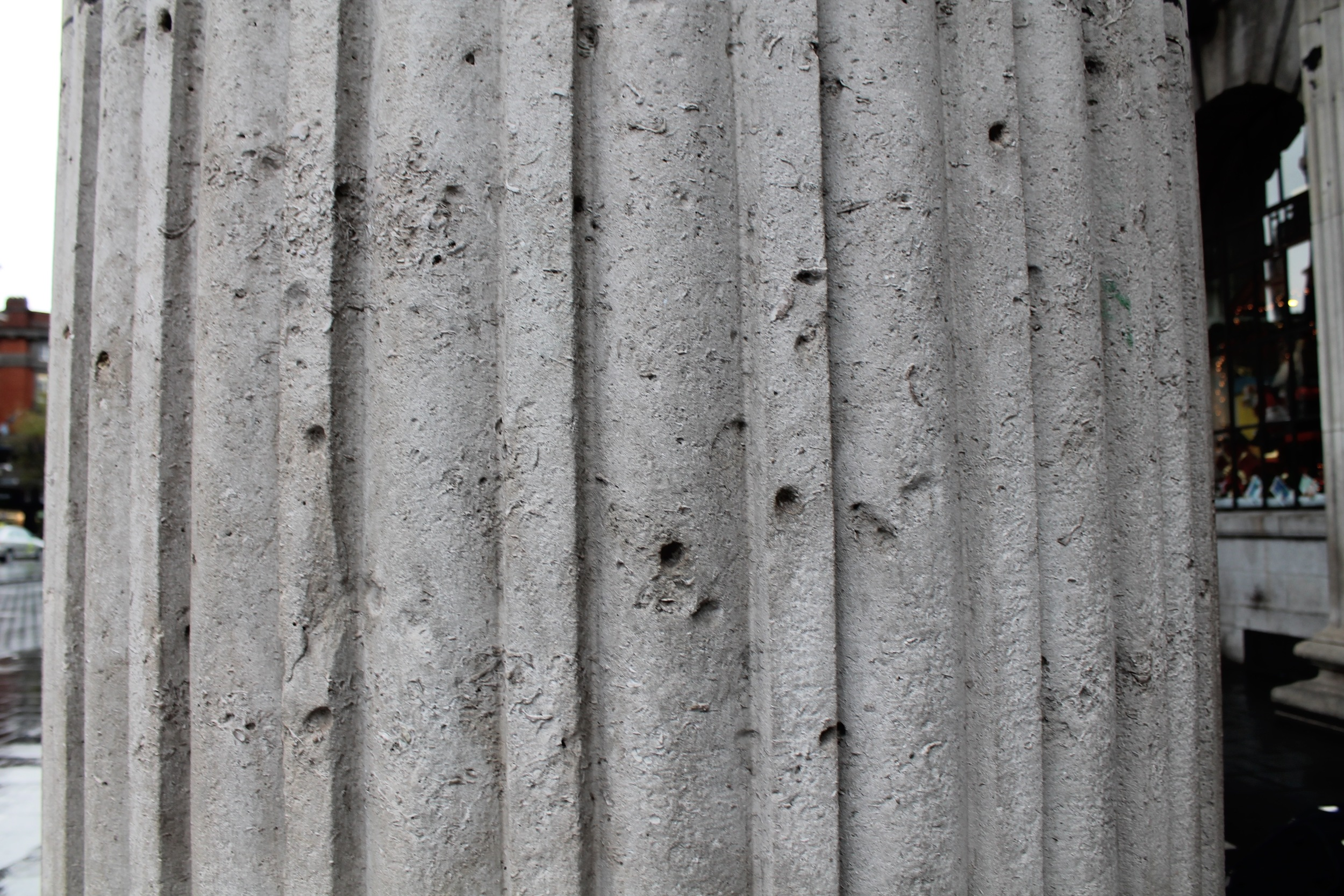 Bullet holes in the pillars outside the GPO