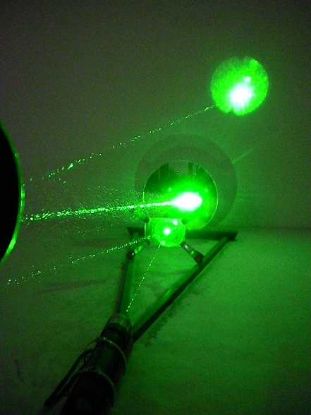 "Artifact, 2011   4' x 12"" x 24""  Poplar, Mirrors, High-powered Astronomical Laser (500mw)"