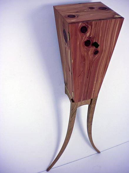 Vertigo Cabinet , 2010     18'' x 13'' x 43''    Aromatic Cedar, Cherry, Rubber
