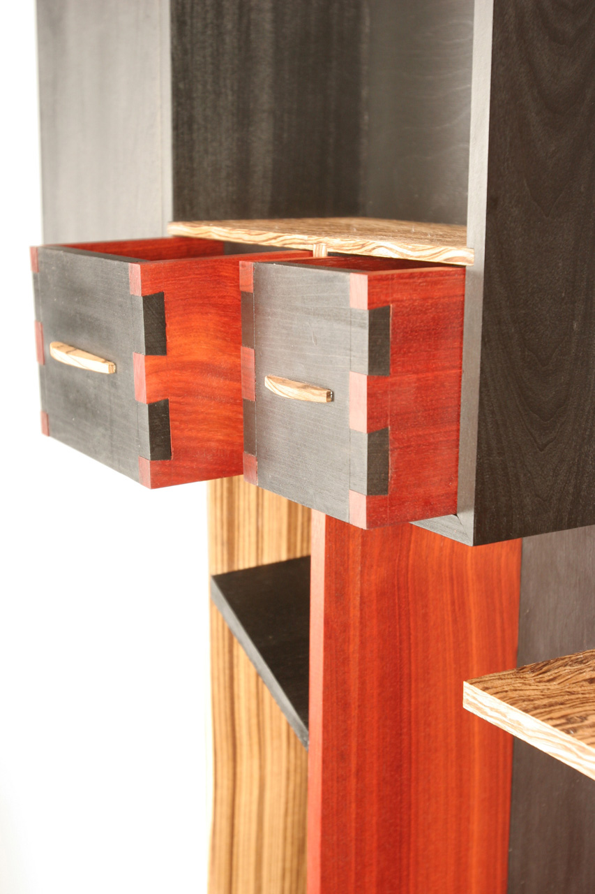 Wine Cabinet (Detail) , 2008   18'' x 8'' x 63''  Bloodwood, Zebrawood, Leather Dyed Poplar, Curly Zebrawood veneer